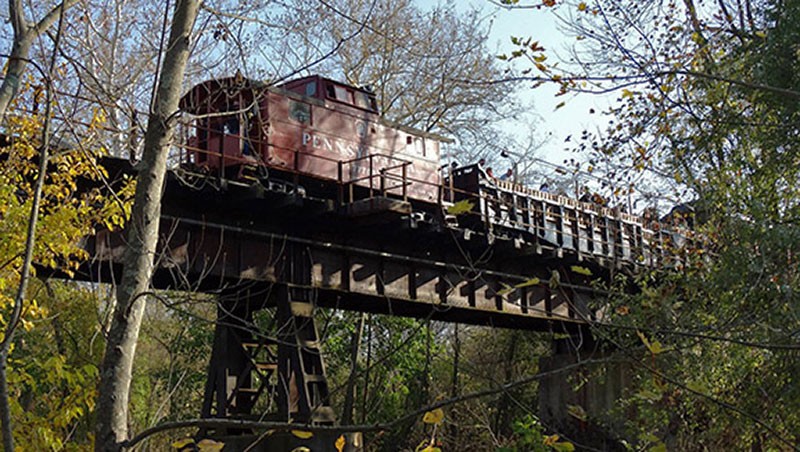 Colebrookdale Railroad caboose going across trestle