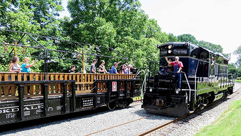 Colebrookdale Railroad open car passing locomotive